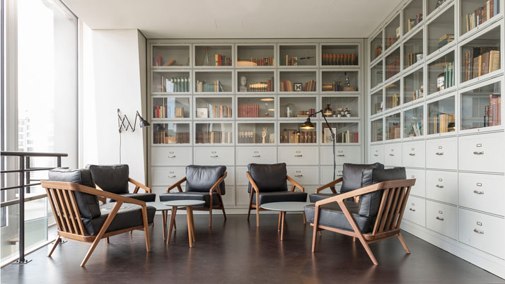 Custom designed built-in shelving to display books and historical knick-knacks.photo © Christian Köster, Aerogram studio.