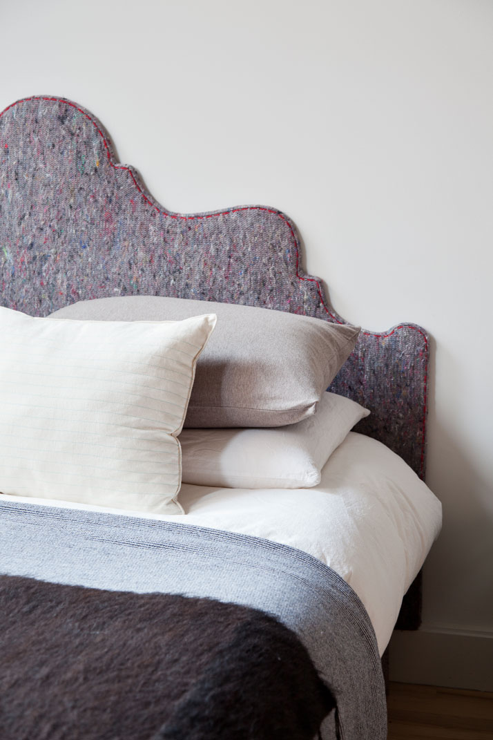 A humble felt blanket has been used to upholster the Victorian-inspired headboard by MiCasa. Photo © Fran Parente.
