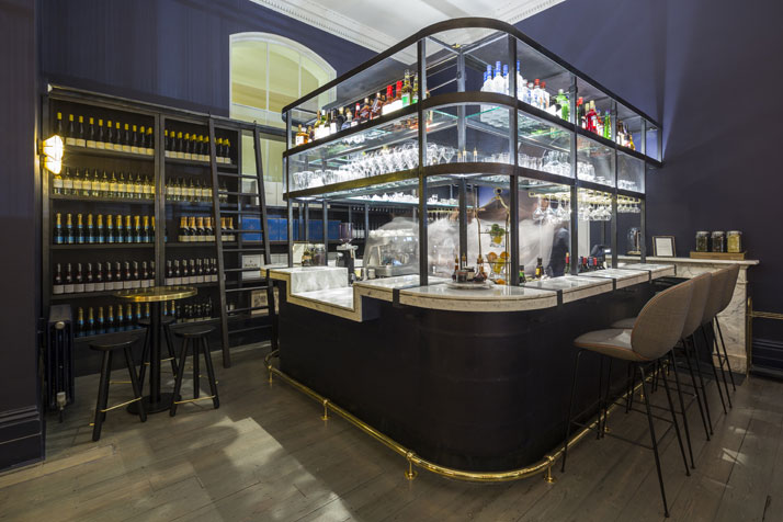 The 'Brew Bar', covered in patent leather and Carrara marble, brews coffee during daytime and serves special beers and fine wines at night. Photo by Gareth Gardner.