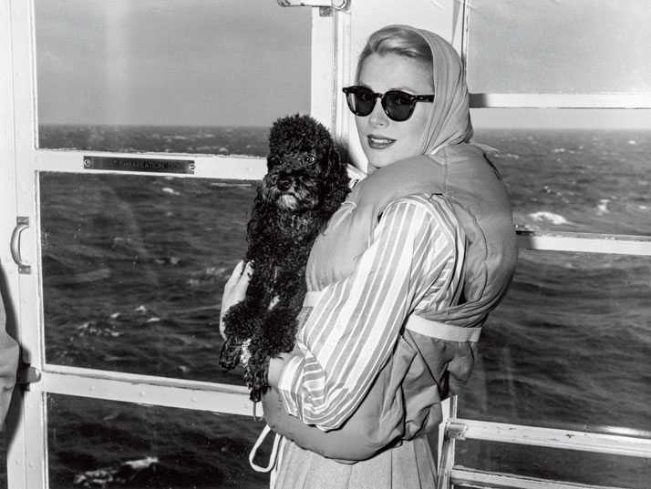 Photo from the book The Stylish Life - Yachting, published by teNeues. Grace Kelly in Lifejacket, Photo © Bettmann/CORBIS.