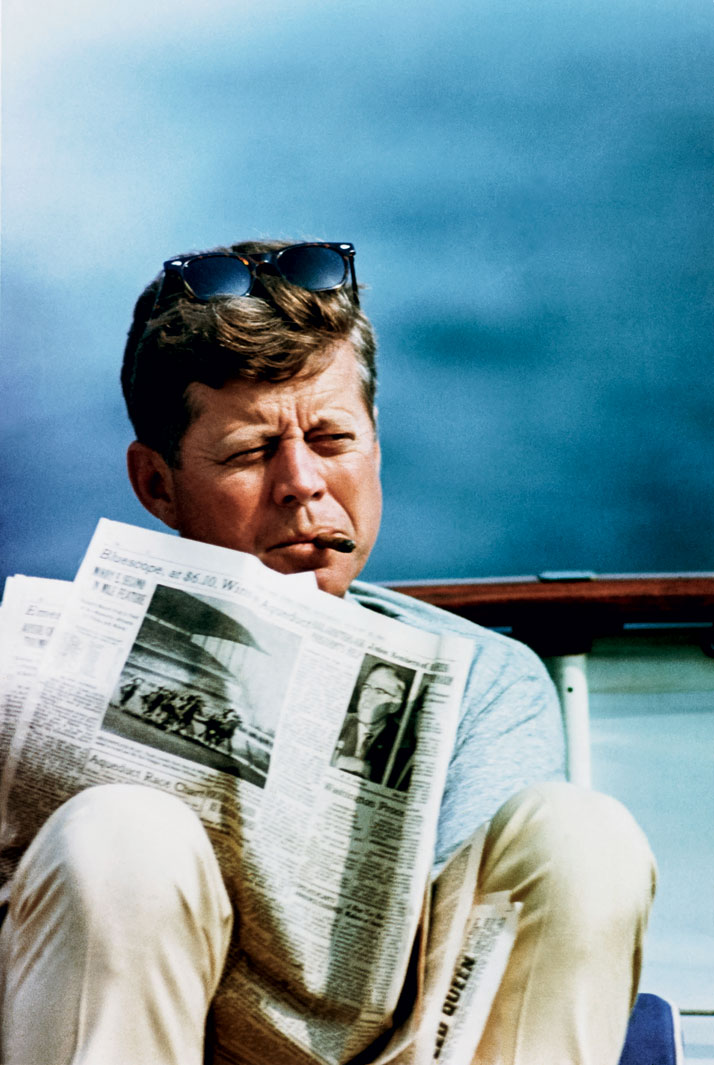 Photo from the book The Stylish Life - Yachting, published by teNeues. John F. Kennedy with Newspaper and Cigar, Photo © CORBIS.