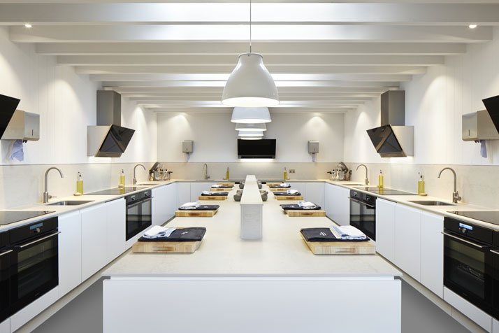 A more contemporary and stark aesthetic was deployed in the cookery school area, situated in an adjoining barn building that dates from 1811. Photo © Jack Hobhouse.