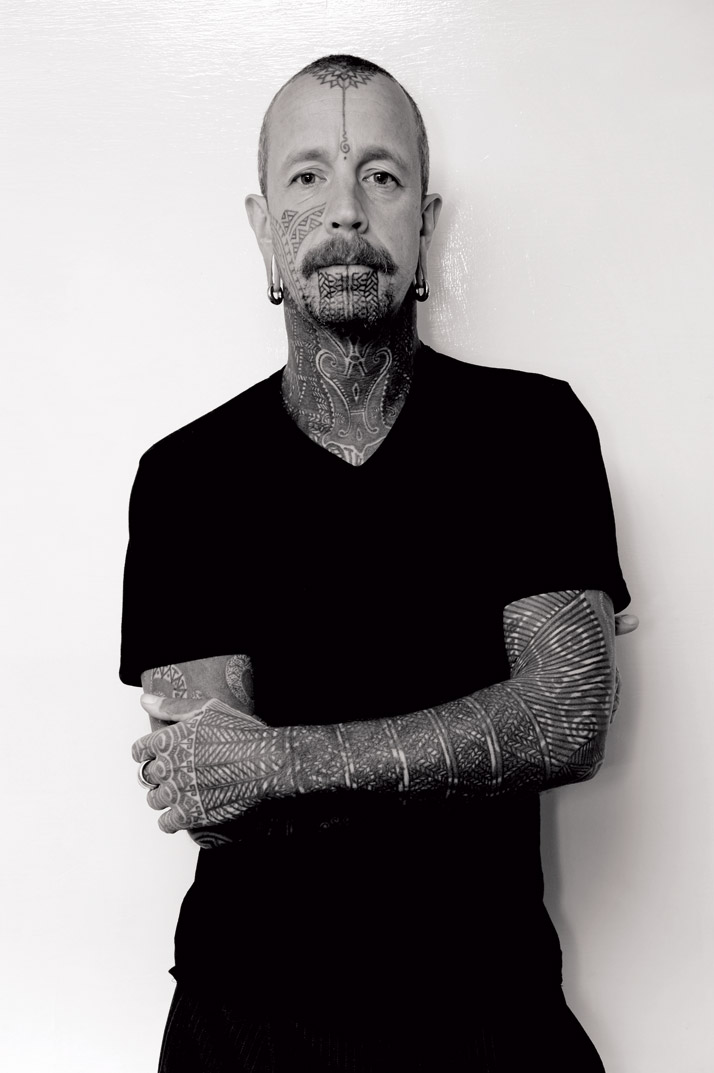 Portrait  of tattoo artist Curly. Photography by Woody of High Wycombe. From the  book 'Forever: The New Tattoo'. Copyright Gestalten 2012.