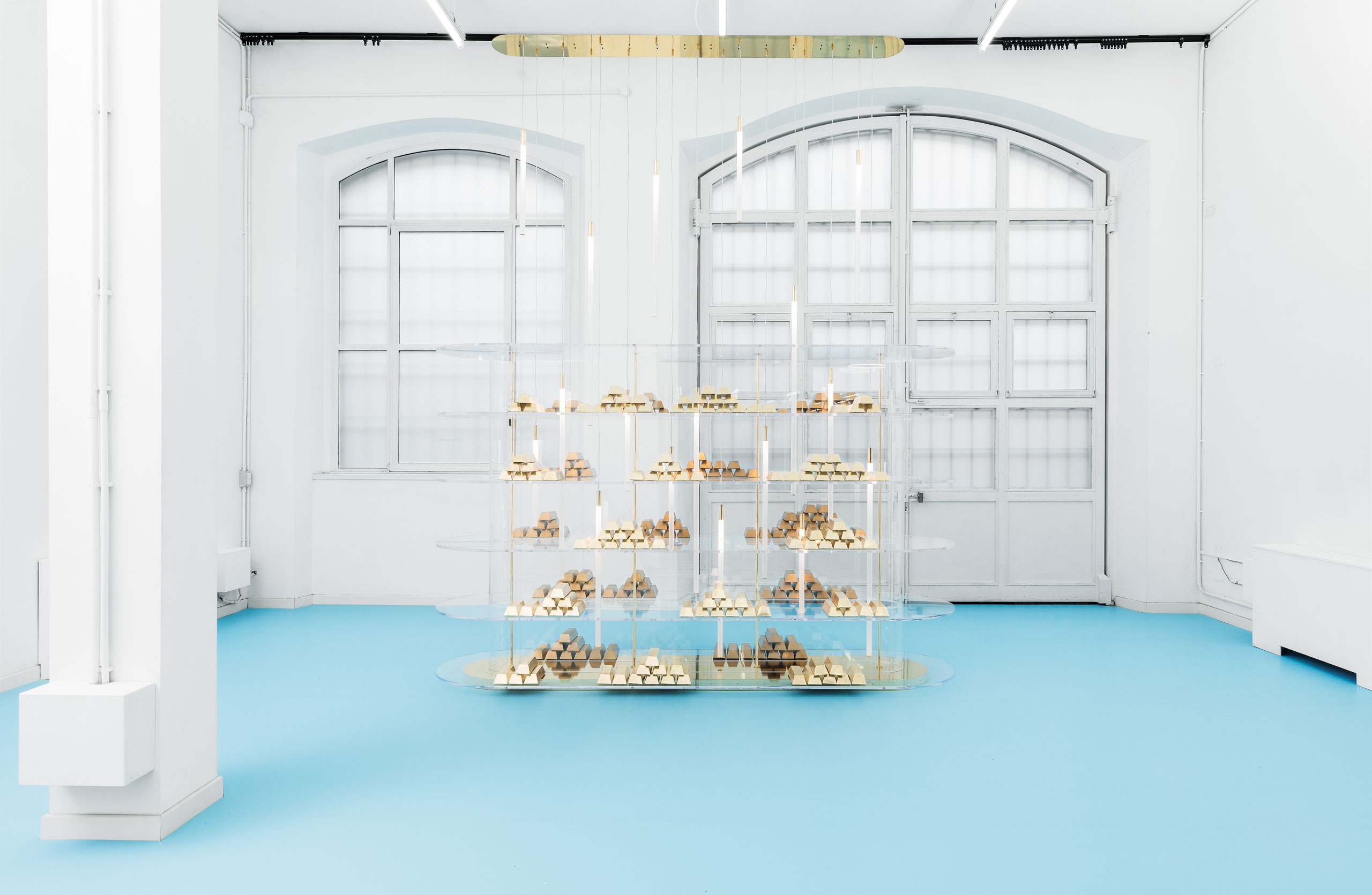 GOD project by Alberto Biagetti and Laura Baldassari curated by Maria Cristina Didero. Tornello : Table with structure in chrome plated steel, details in polished brass and ultra-white glass top.-120 x 185 x H 72 cm-47 x 73 x H 28 inches-Photo by Delfino Sisto Legnani, ©Atelier Biagetti.