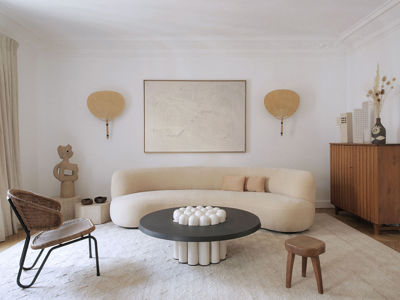 Curved sofa in Pierre Frey mohair fabric by Pierre Augustin Rose, 2018. Coffee table in lava stone and raku by Emmanuelle Simon,2018. Rattan chair,model 568 by Dirk Van Sliedregt, 1954. Photography by Damien de Medeiros.