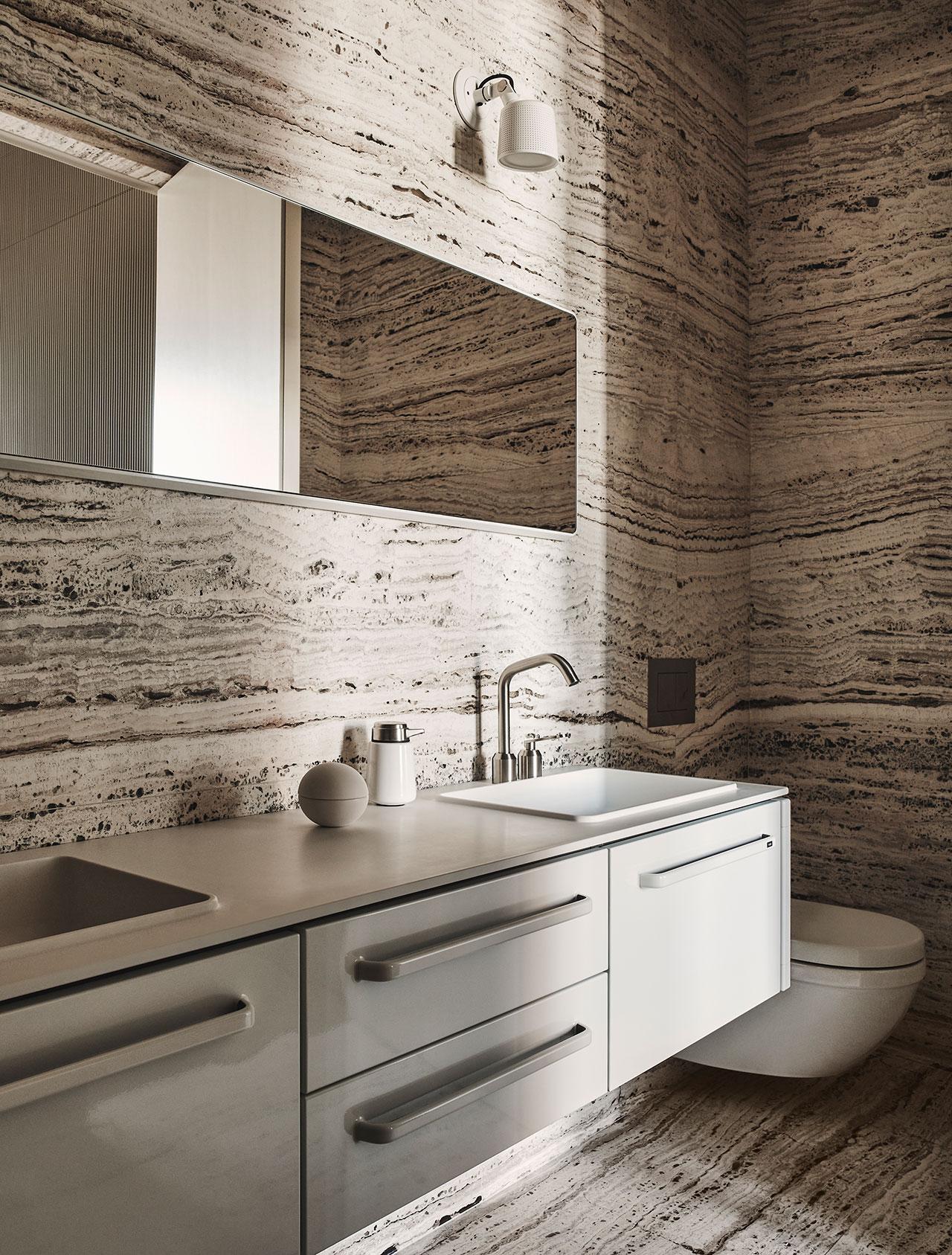 Photography by Adrian Gaut.Styling by Colin King. © Vipp Master bathroom:Perisian travertine,White Vipp pendant lights, White Vipp Bathroom Module, Large, Vipp Bathroom Mirror, Large.