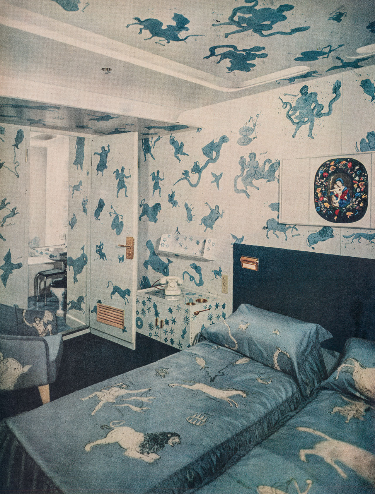 Gio Ponti with Piero Fornasetti, Zodiac Suite, ocean liner Andrea Doria, 1950. Colored photograph from an Andrea Doria advertising brochure. Ponti and Fornasett achieved a game of reversals with the blue-and-white pattern on pattern, engulfing the entire room and distorting spatial reading, but with an unexpected intimacy of enchantment. Photo courtesy Paolo Piccione Collection.