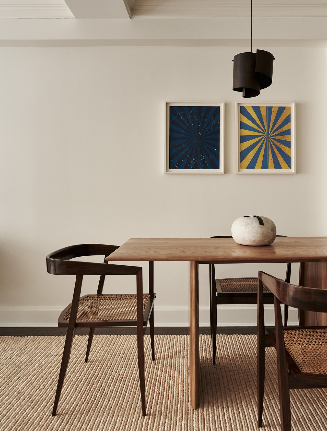 Photography by Adrian Gaut. Styling by Colin King. Featured: Bespoke dining table bySandra Weingort fabricated by Casey Johnson Studio; Dining chairs byJoaquim Tenreiro circa 1960 from Bossa Furniture; Pendant lamp byJørn Utzon circa 1960 from Galerie Half; Vase byHeyja Do from Dear Rivington; Artwork (Diptych) byMark Grotjahn from Anton Kern Gallery.
