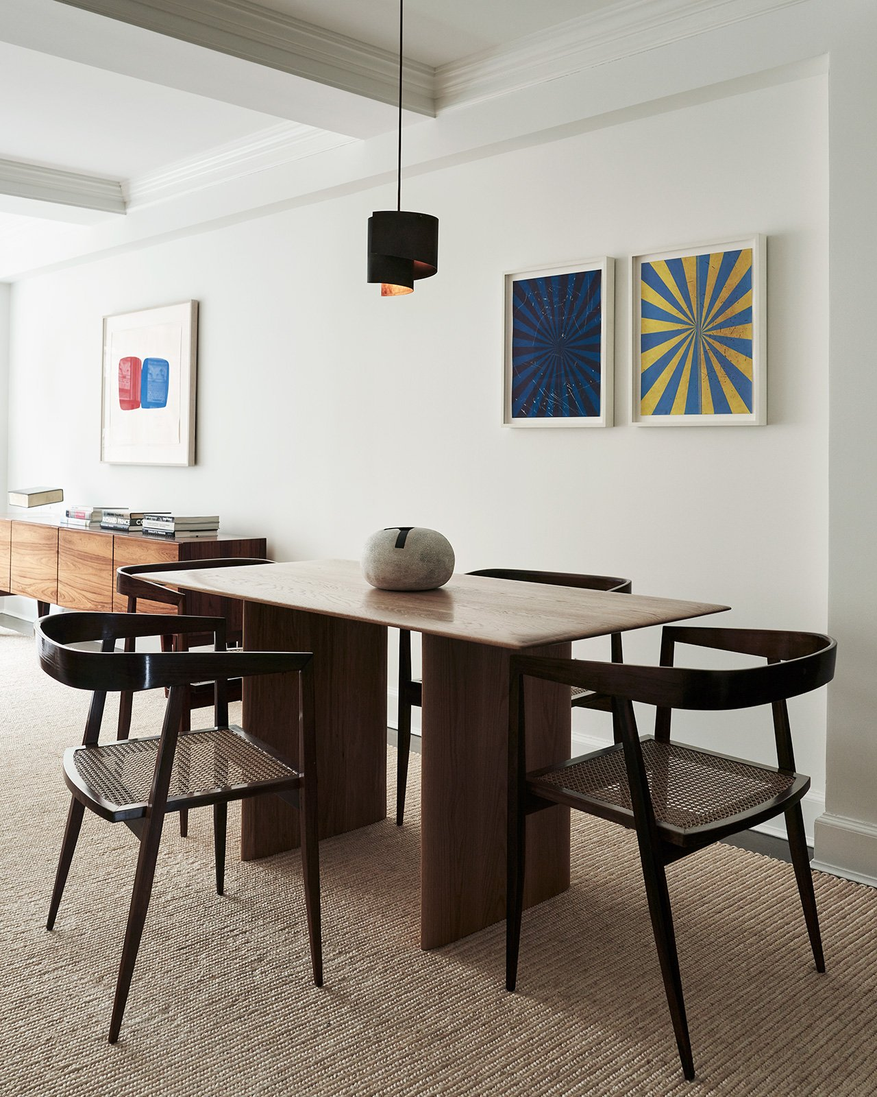 Photography by Adrian Gaut. Styling by Colin King. Featured: Bespoke dining table bySandra Weingort fabricated by Casey Johnson Studio; Dining chairs byJoaquim Tenreiro circa 1960 from Bossa Furniture; Pendant lamp byJørn Utzon circa 1960 from Galerie Half; Artwork (Diptych) byMark Grotjahn from Anton Kern Gallery.