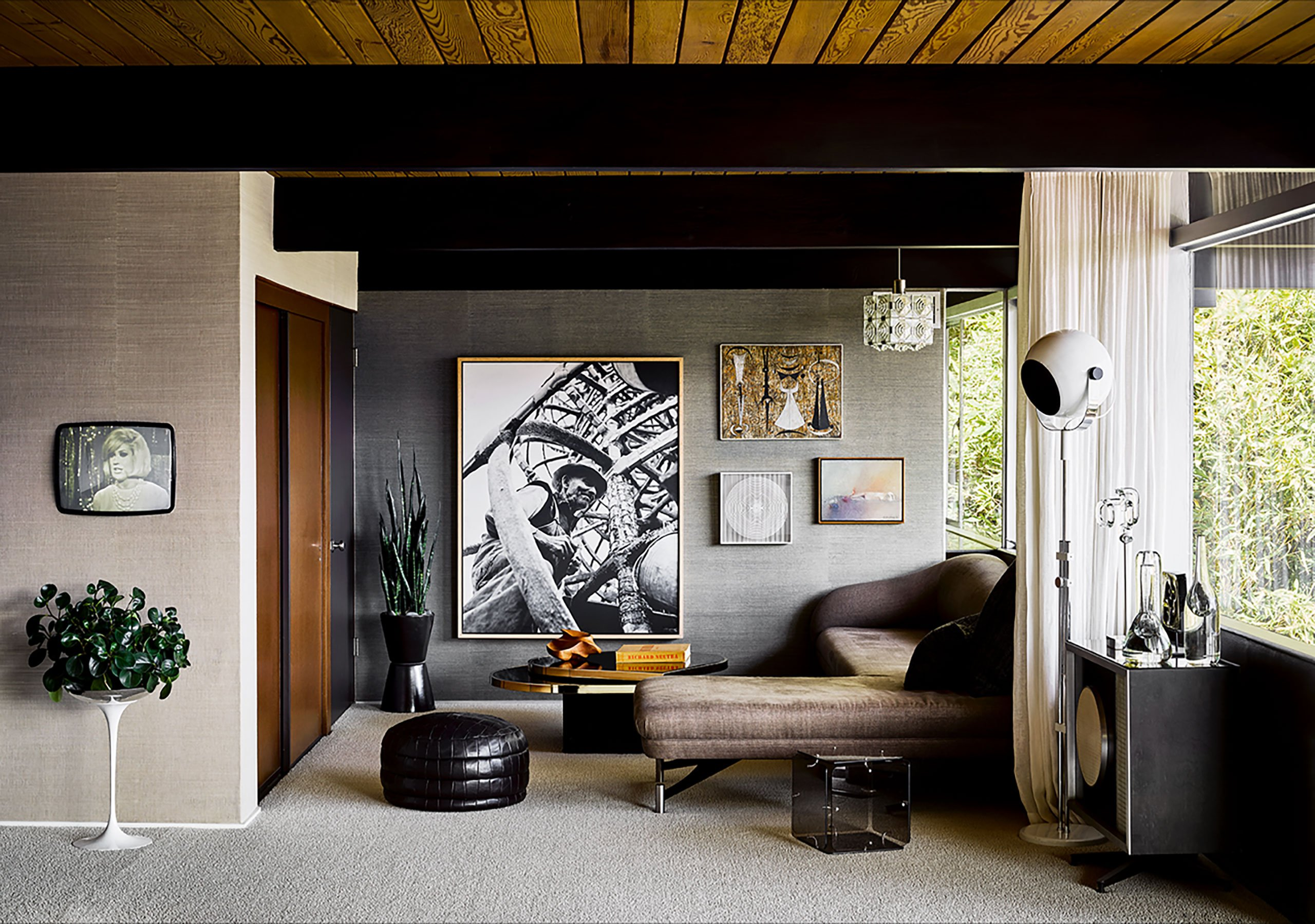 Photography by Douglas Friedman. Featured: Swan sofa by Vladimir Kagan; original built-in TV, Eames Speaker used as side table; glass cube table by Gerard McCabe; leather patchwork ottoman by DeSede.