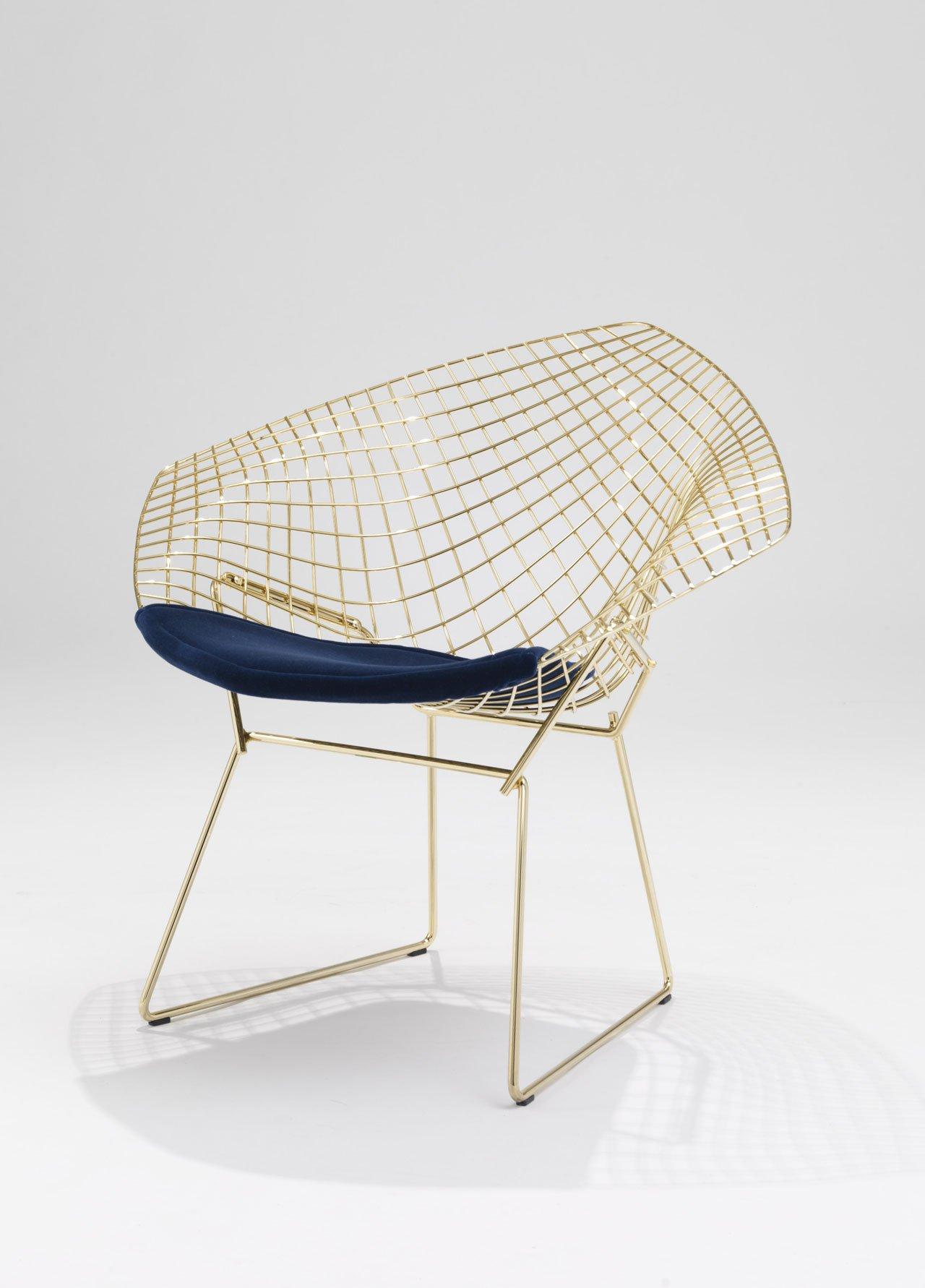Diamond Chair in cowhide and with a new bronze finish by Harry Bertoia for Knoll. Photo by Ezio Prandini.