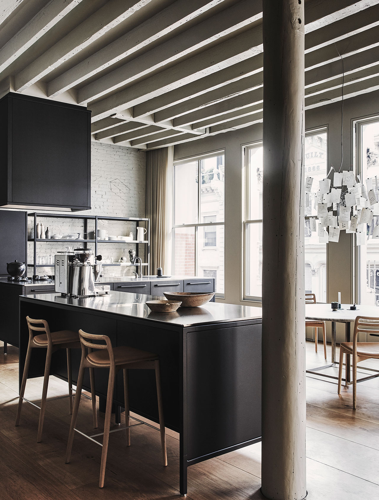"""Photography by Adrian Gaut.Styling by Colin King. © Vipp Featured:Vipp kitchen Island Module with seating, Vipp kitchen Island Module with Cooking Hood, Vipp kitchen Tall Module with appliances,Vipp Tall Racks, Custom Eric Bruce Kvadrat cotton curtains, Farrow & Ball """"Drop Cloth"""" paint."""
