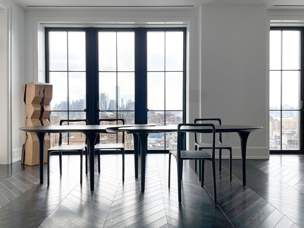 Galerie Philia at Walker Tower, Chelsea, New York. Courtesy of Galerie Philia. Featured: Vince Skelly, Corsica Tower, 2020. Oak. 30 x 30 x 127 cm. Cedric Breisacher, Dot chair, 2020. Hand-sculpted solid oak. H 46/80 cm x P 44 cm x L42 cm. Cedric Breisacher, Dining table, 2020. Hand-sculpted plane tree.