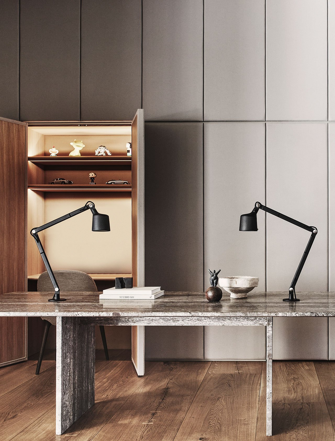 Photography by Adrian Gaut.Styling by Colin King. © Vipp Featured: Custom millwork conceal the workstations (when the doors are closed the upholstered wall soften the space and absorb sound), Custom Vipp table in travertine, Vipp Table Lamps.