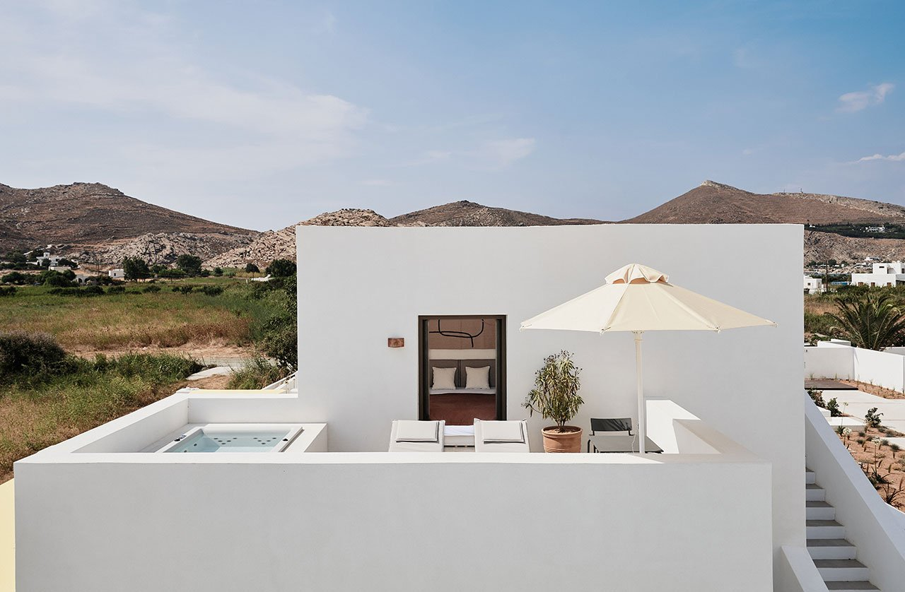 Uranus Suite with private terrace and Jacuzzi. © Parīlio a member of Design Hotels™ | Kolympithres,Naoussa Paros, Greece.Photo by Claus Brechenmacher & Reiner Baumann. Courtesy of Parīlio.