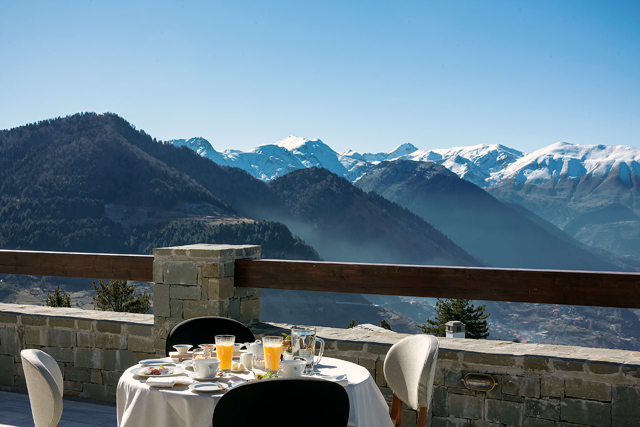 Sweeping alpine views of the surrounding mountains and valleys from the breakfast terrace. © Grand Forest Metsovo | Metsovo, Greece.Photo by Christos Drazos.