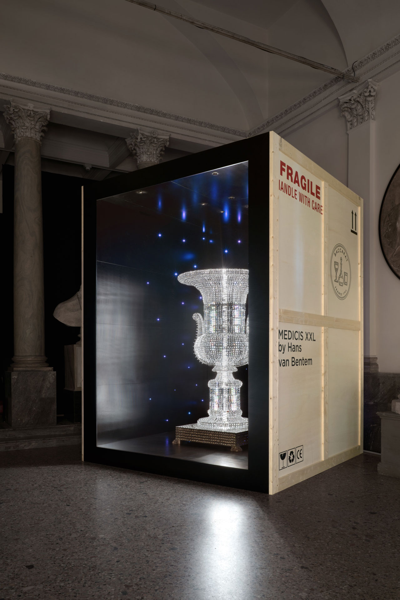 Lumières out of the box installation view at the Fine Arts Academy of Brera featuring Medicis XXL by Hans Van Bentem, an authentic masterpiece made of 13.000 octagons, translating the original marble Medicis vase of the classical period and its crystal version made by Baccarat in 1909.
