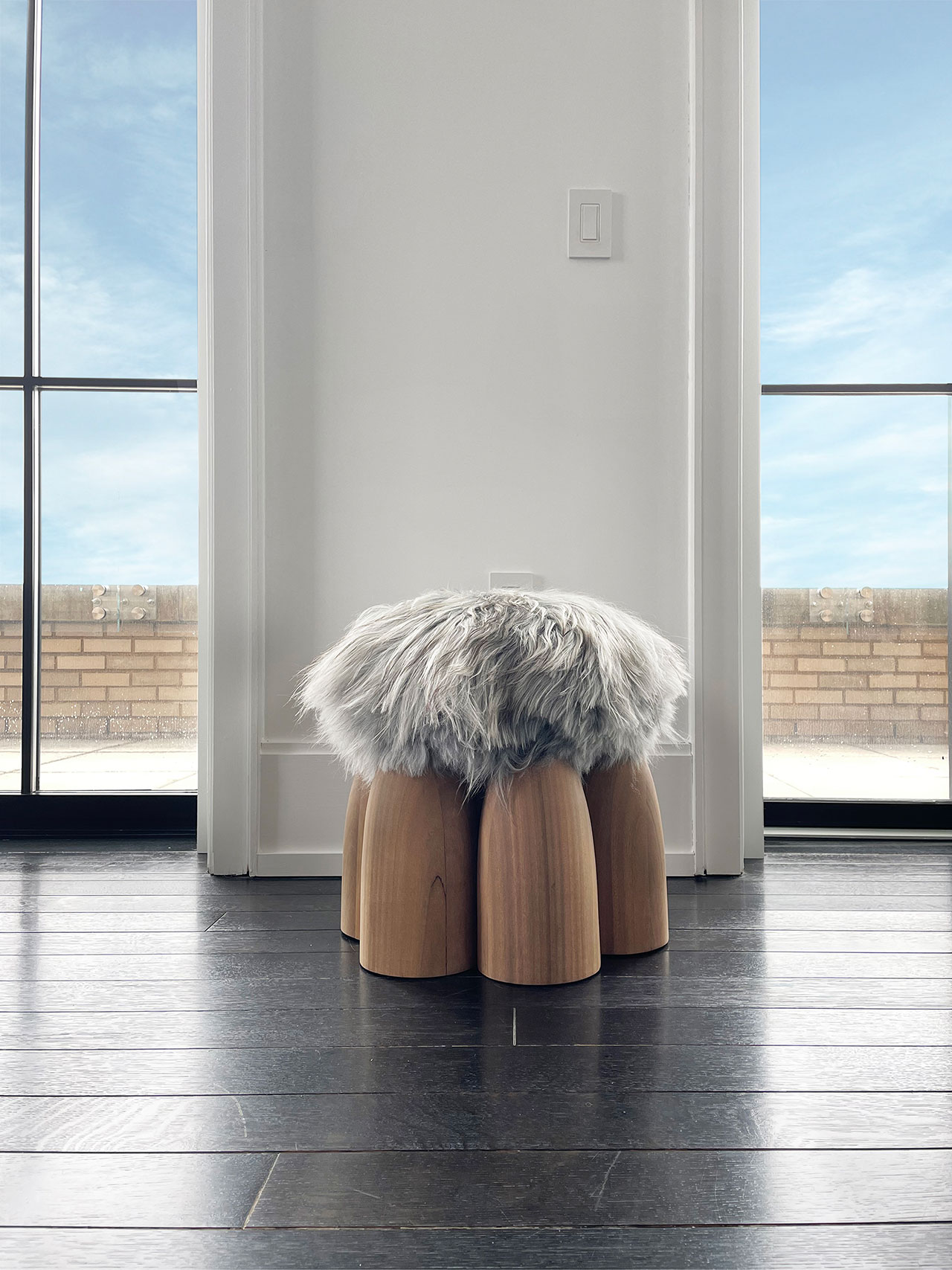 Galerie Philia at Walker Tower, Chelsea, New York. Courtesy of Galerie Philia. Featured: Arno Declerq, Senufo ottoman natural. African walnut and sheep wool. W 45 x D 45 x H 40 cm.