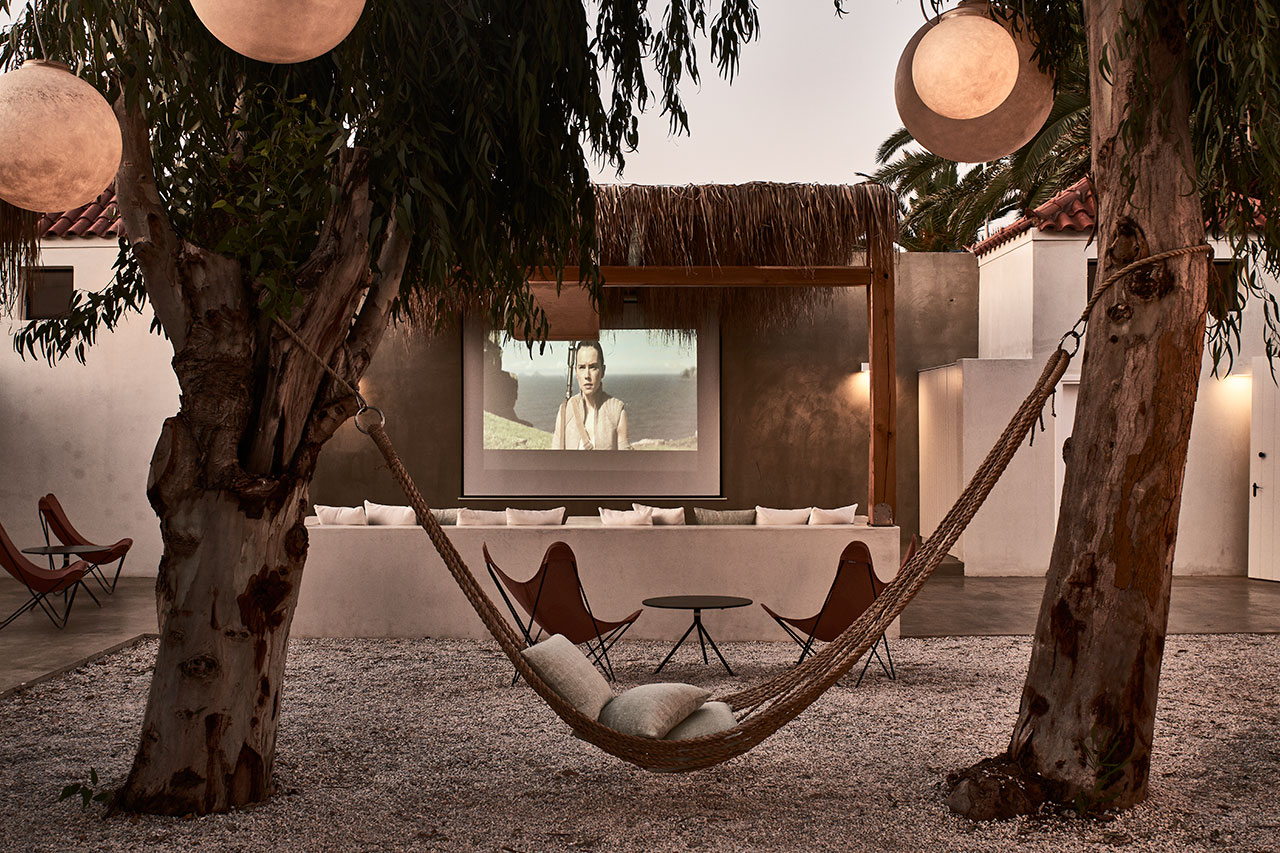 """The Place"" is a youth club for teenagers featuring a cinema screen, a bar area, a ping pong table and hammocks. © Cretan Malia Park Resort a member of Design Hotels™ 