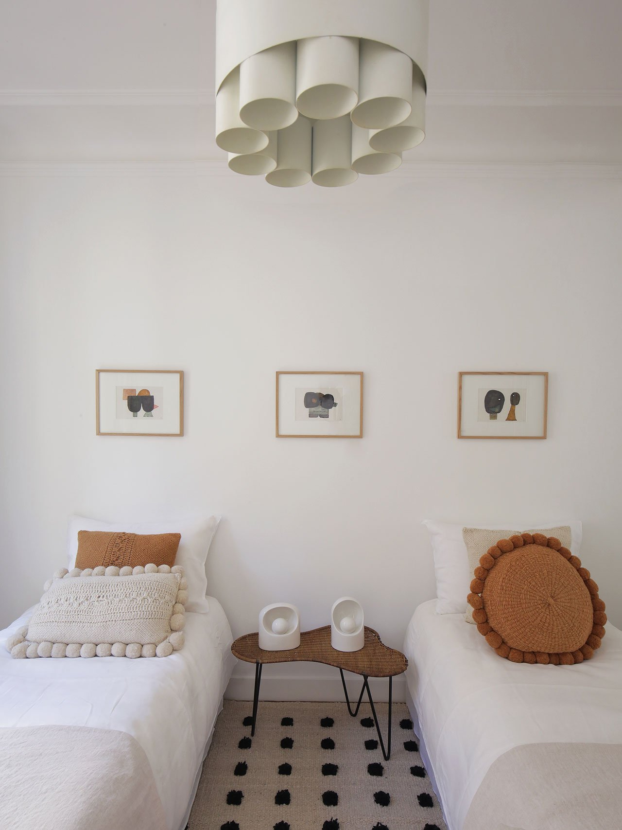 Pendant lightby Jo Hammerborg, circa 1970. Table in rattan and ironby Raoul Guys, 1950. White ceramic table lights by Marcello Cuneo, 1970. Photography by Damien de Medeiros.