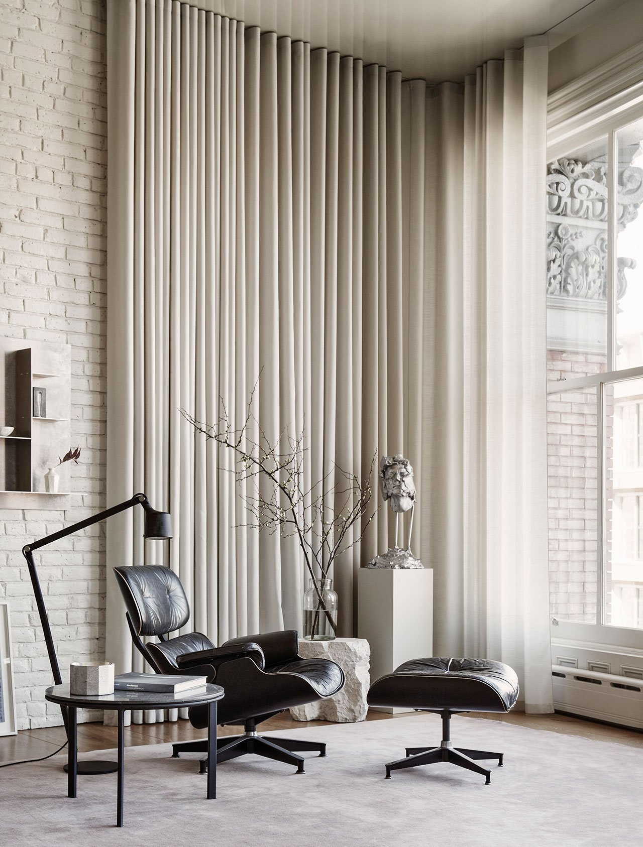 Photography by Adrian Gaut.Styling by Colin King. © Vipp Featured: Vipp side table, Eames Lounge Chair by Charles & Ray Eames, Custom Eric Bruce Kvadrat cotton curtains.