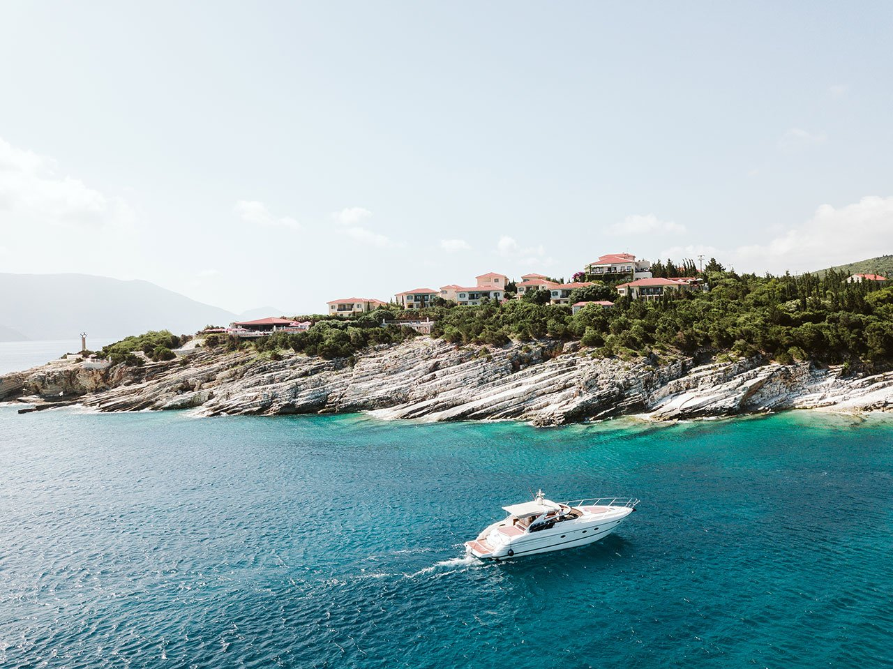 The Hotel overlooks the turquoise waters of Emblisi bay. © Emelisse Nature Resort | Fiskardo, Kefalonia, Greece.Photo by Dimitris Skigopoulos.