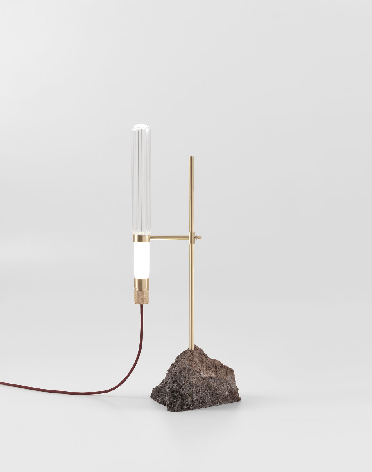 KRYPTAL table lamp by CTRLZAK for JCP Universe.Materials: lava stone base with matte brass structure and glass body.Dimensions (H x W x D): 75cm x 33cm x 15cm.Photo by Silvio Macchi © JCP Universe.