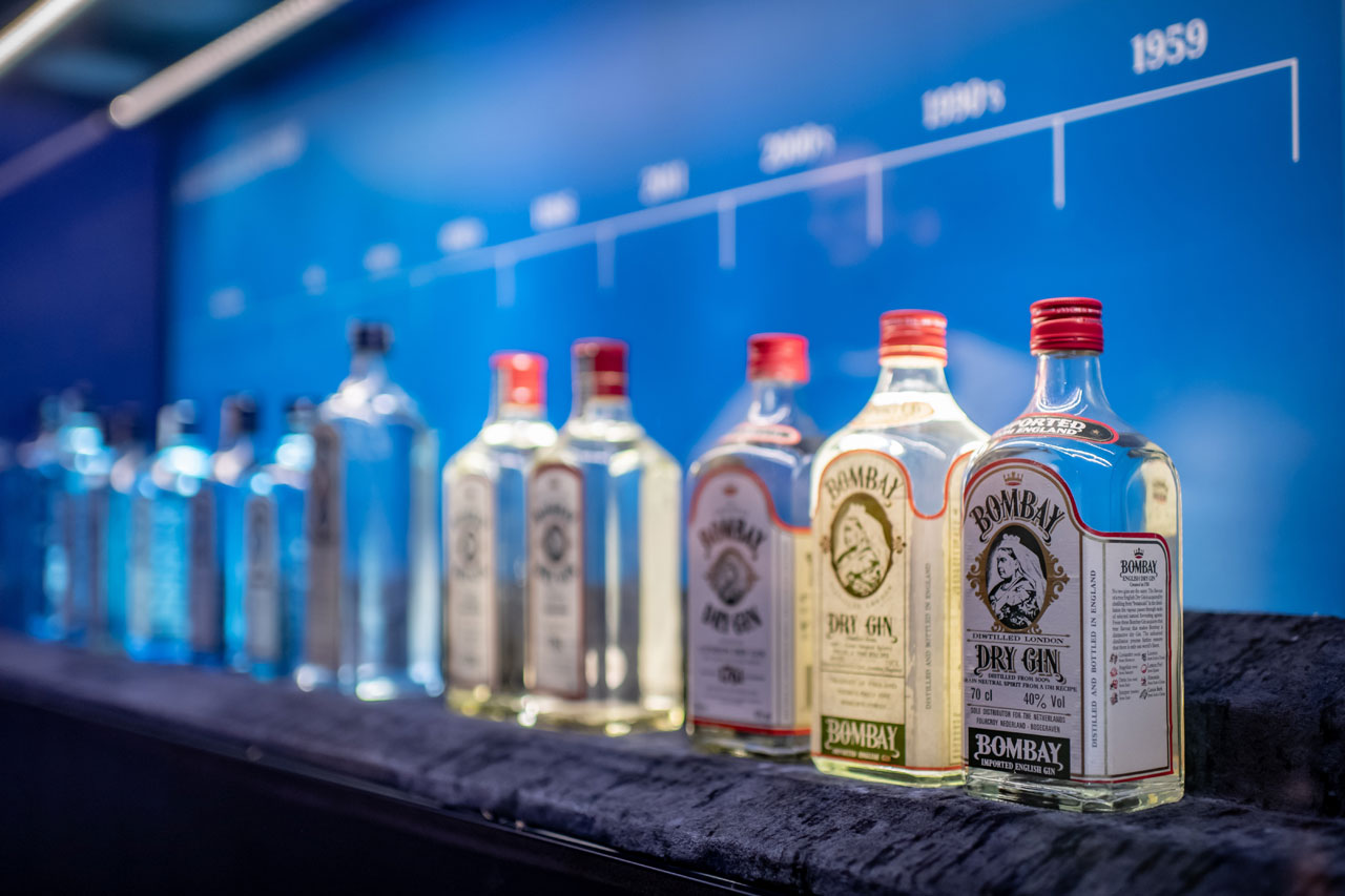 The evolution of Bombay Sapphire bottles at the Museum of the gin's distillery at Laverstoke Mill. Installattion view by Elias Joidos © Yatzerland Ltd.