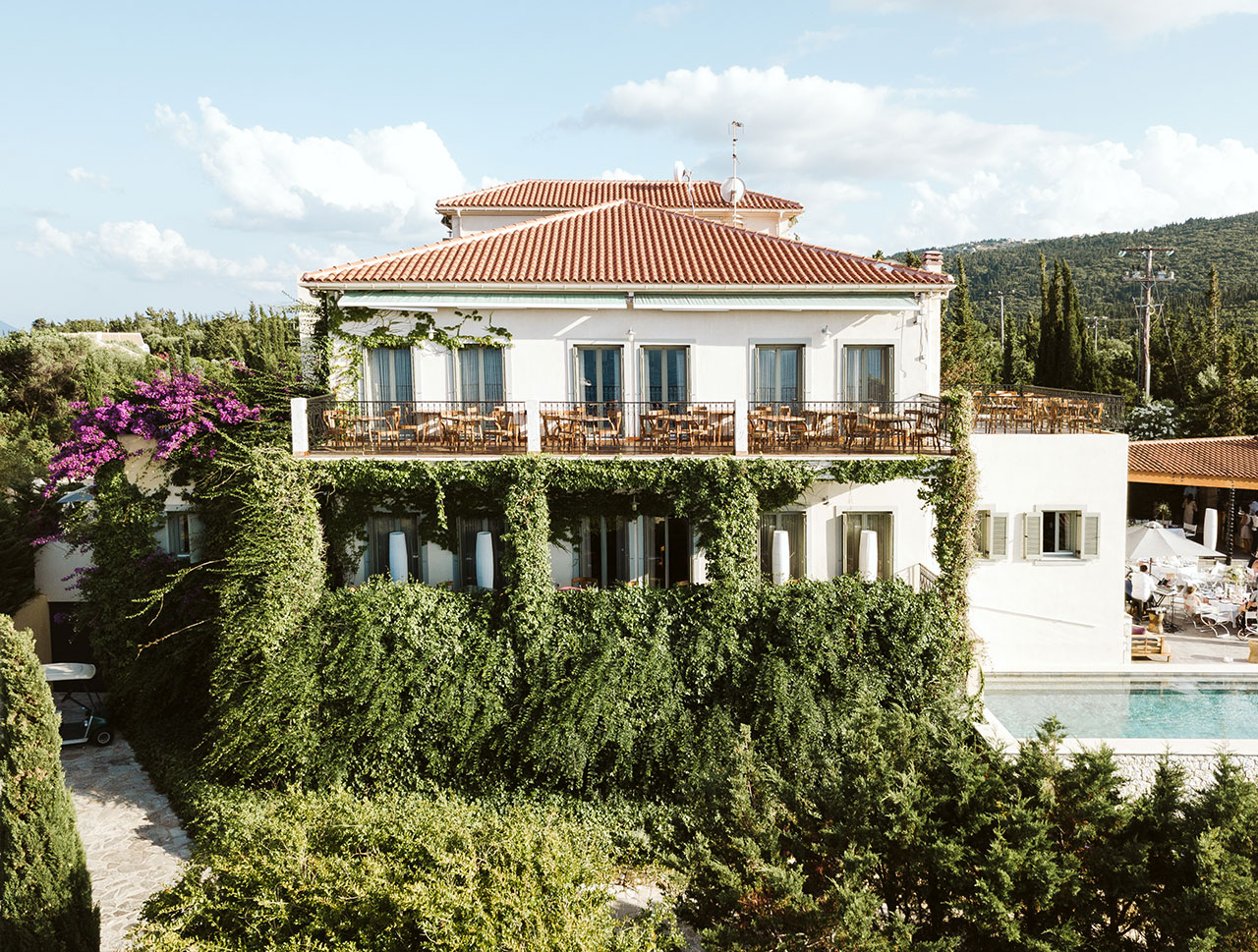 The evergreen gardens envelope the Hotel's cliff-top buildings. © Emelisse Nature Resort | Fiskardo, Kefalonia, Greece.​​​​​​​Photo by Dimitris Skigopoulos.