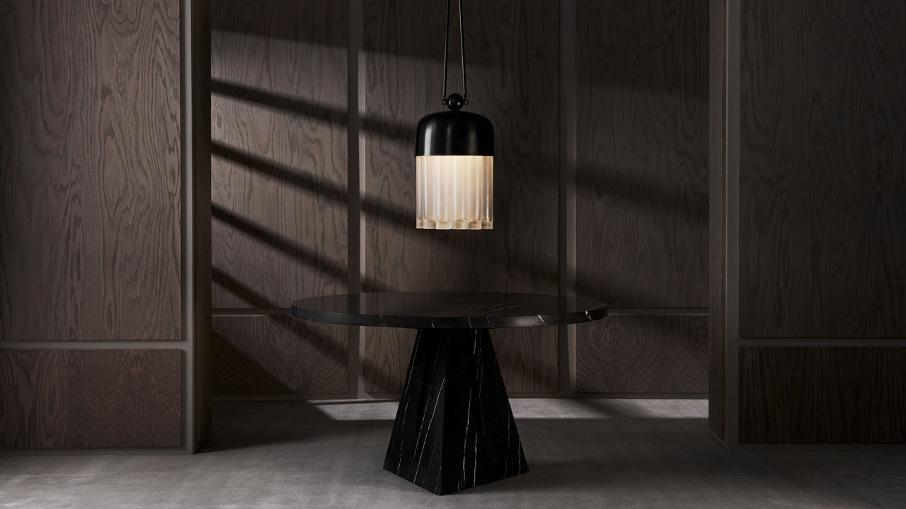 PORTAL marble dining table andTASSEL ceiling light byAPPARATUS studio.