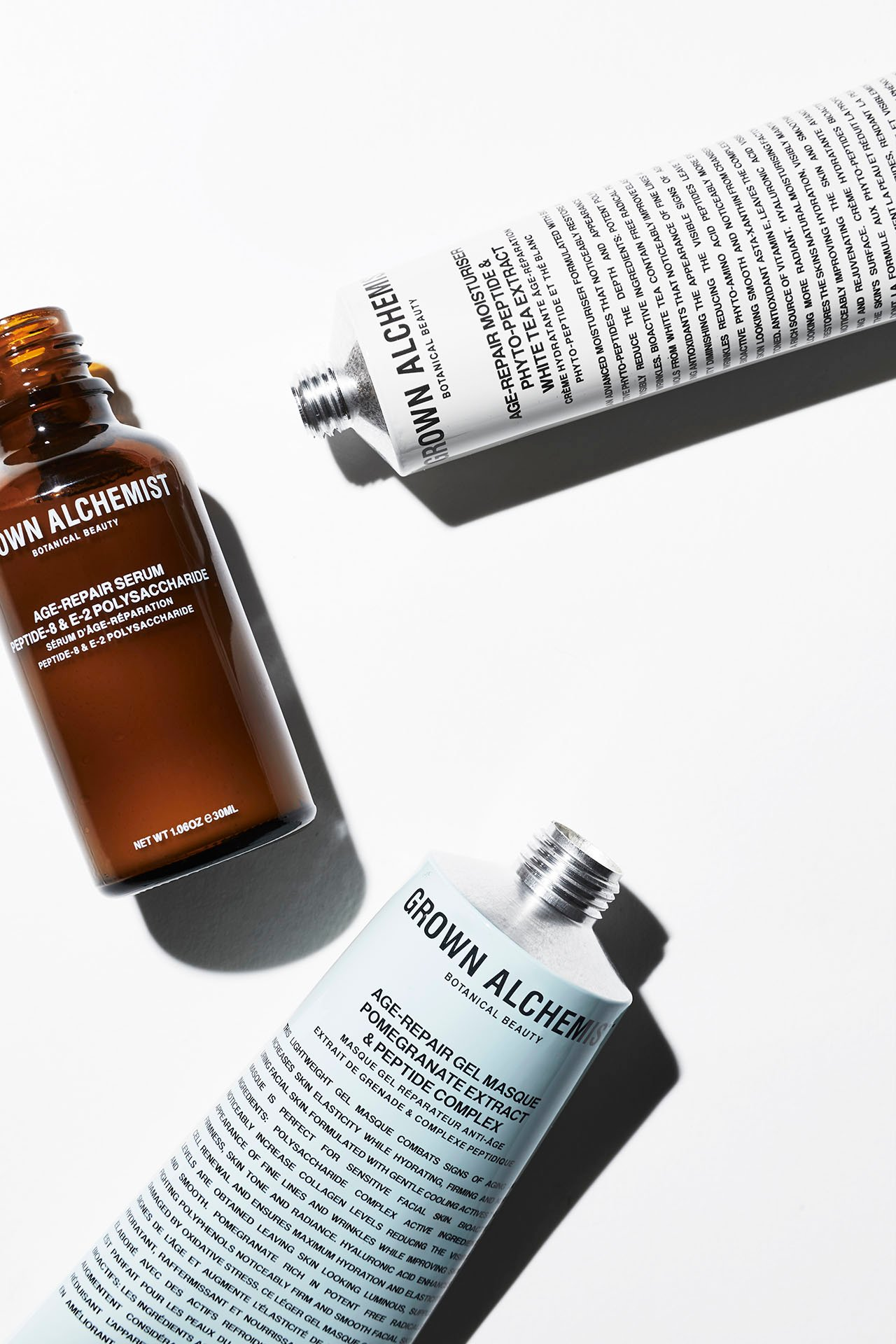 Age-Repair Moisturiser (Phyto-Peptide, White Tea Extract),  Age-Repair Gel Masque (Pomegranate Extract, Peptide Complex) & Age-Repair Serum (Peptide-8, E-2 Polysaccharide).Photo © GROWN ALCHEMIST.