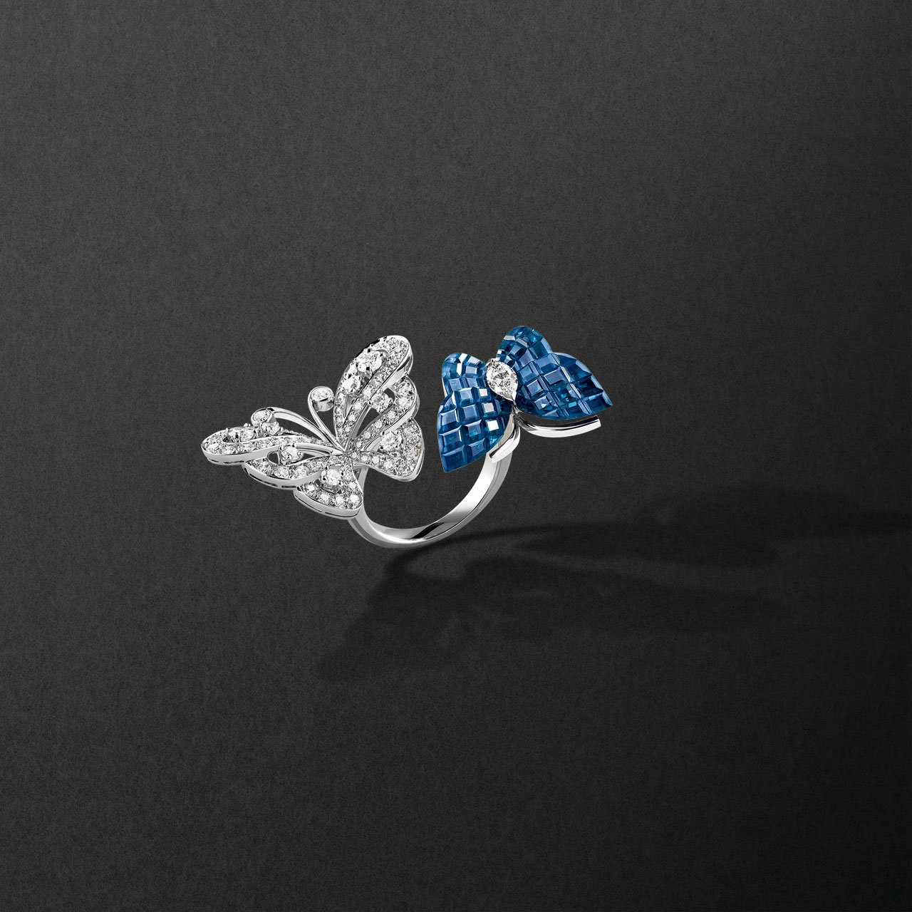 Flying butterfly ring, 2007. White gold, red gold, Mystery-Set sapphires and diamonds. Photo Coppi Barbieri.