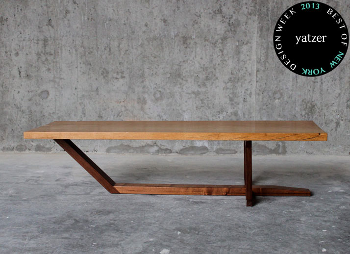 A single 100+ year old oak slab atop a solid NC walnut cantilever base makes for the coffee table by Elijah Leed Studio.