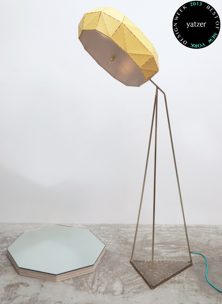 'Outpost' floor lamp by Erich Ginder which features a rotating geometric fabric shade, on a cast iron base.