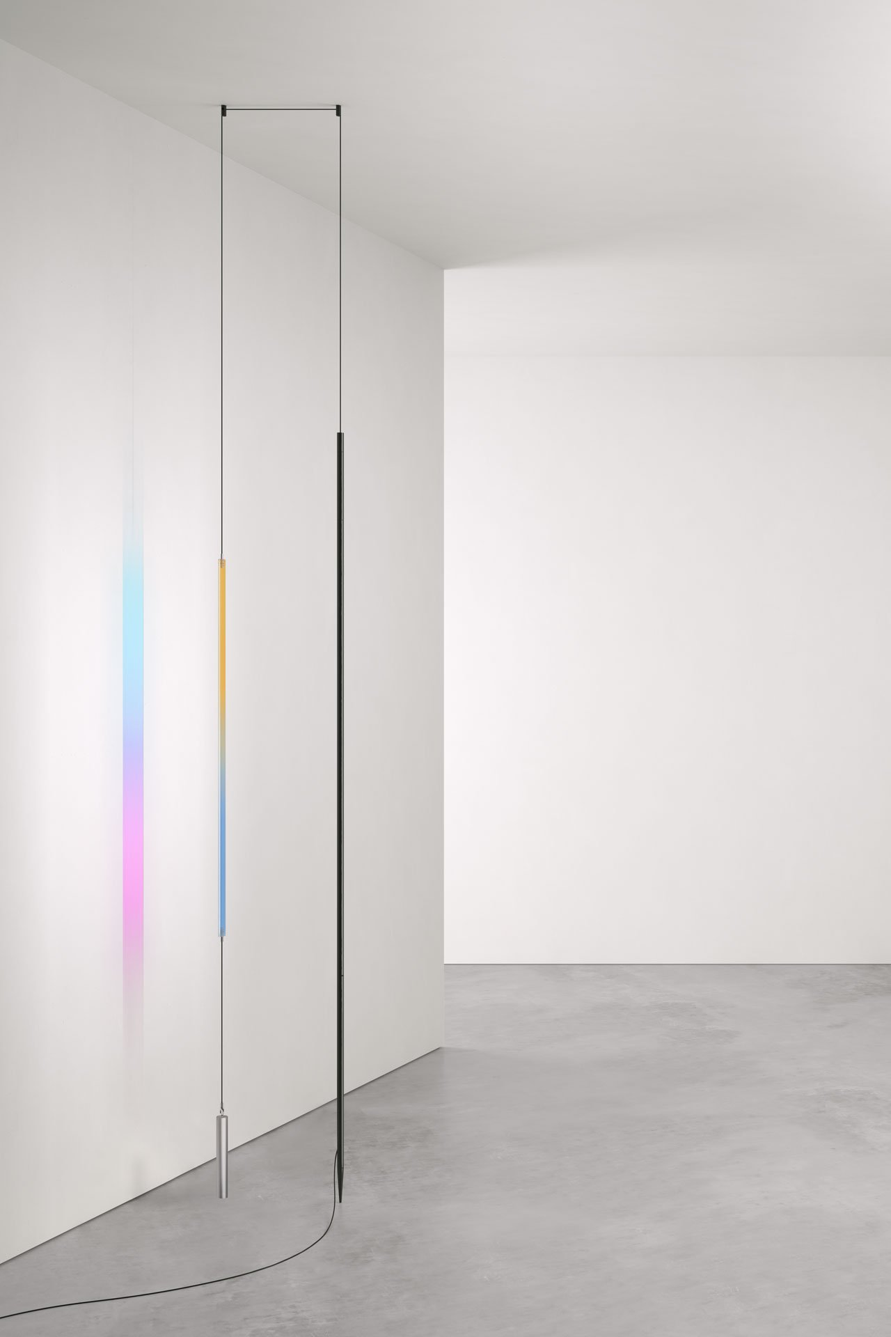 Blush lamp made of a Led strip and a piece of dichroic glass which casts brightly-tinted reflections on walls, designed by Studio Formafantasma for FLOS.