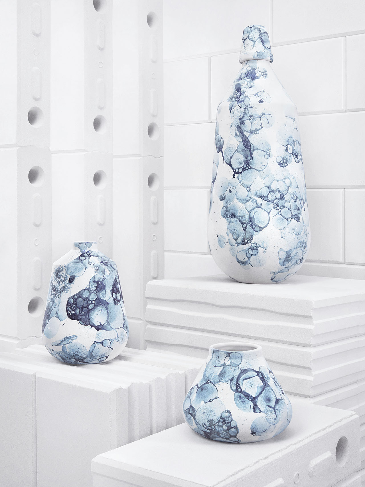 Bubblegraphy series of vases by Adrianus Kundert in collaboration with Thomas van der Sman for Oddness.  The pattern on each vase is created by a special process of blowing air bubbles in the glaze. Photo © Oddness.