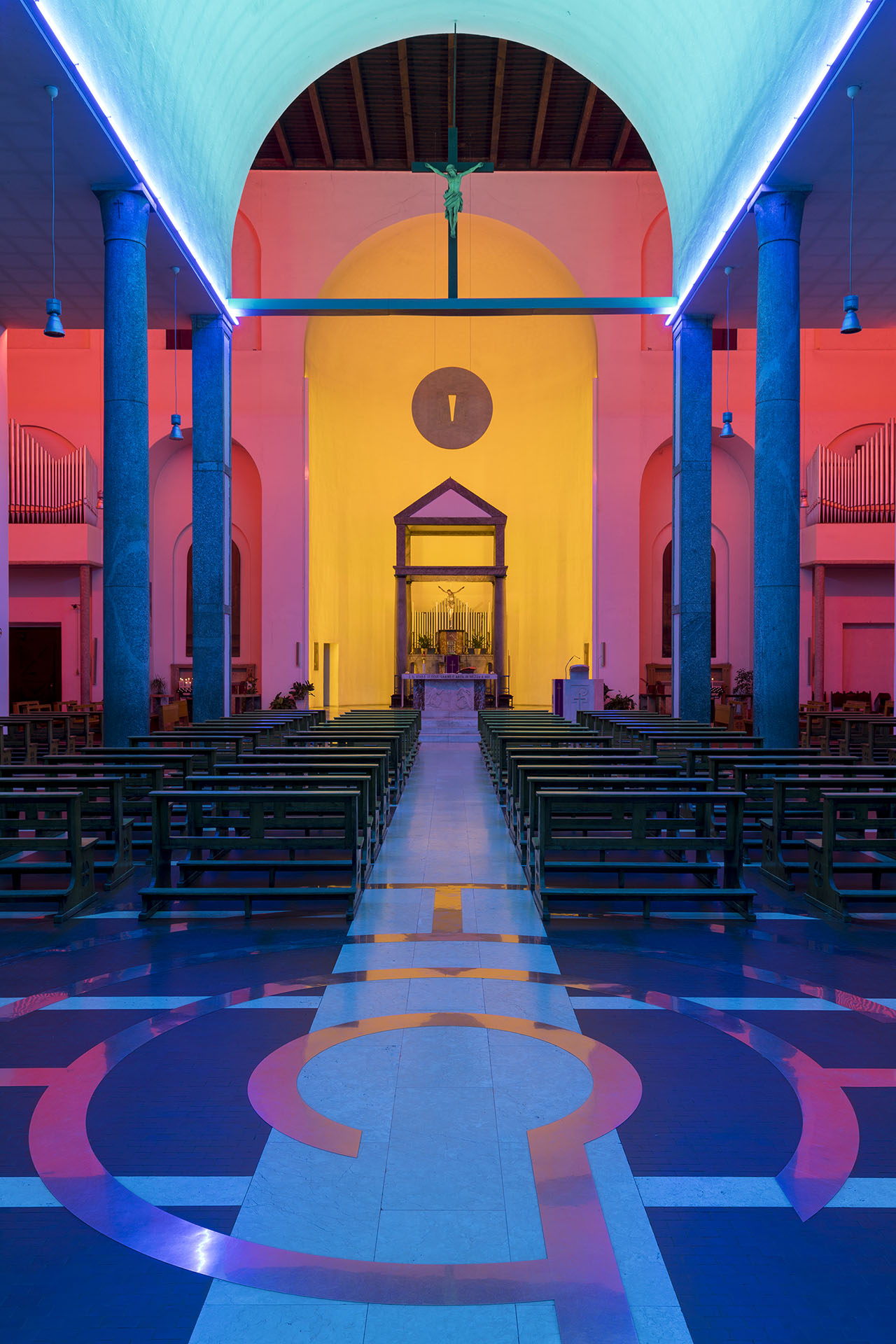 Untitled site-specific permanent installation conceived by Dan Flavin for the Santa Maria Annunciata in Chiesa Rossa, the church in Milan designed by architect Giovanni Muzio in 1930s. Made of green, blue, pink, golden and ultraviolet light, the work suggests the natural 'night-dawn-day' progression of light while walking through the entryway.⠀⠀S.Maria Annunciata in Chiesa Rossa.via Neera, 24, Milan.Open from 4 to 7 pm.⠀ Photo: Roberto Marossi.Courtesy Fondazione Prada.