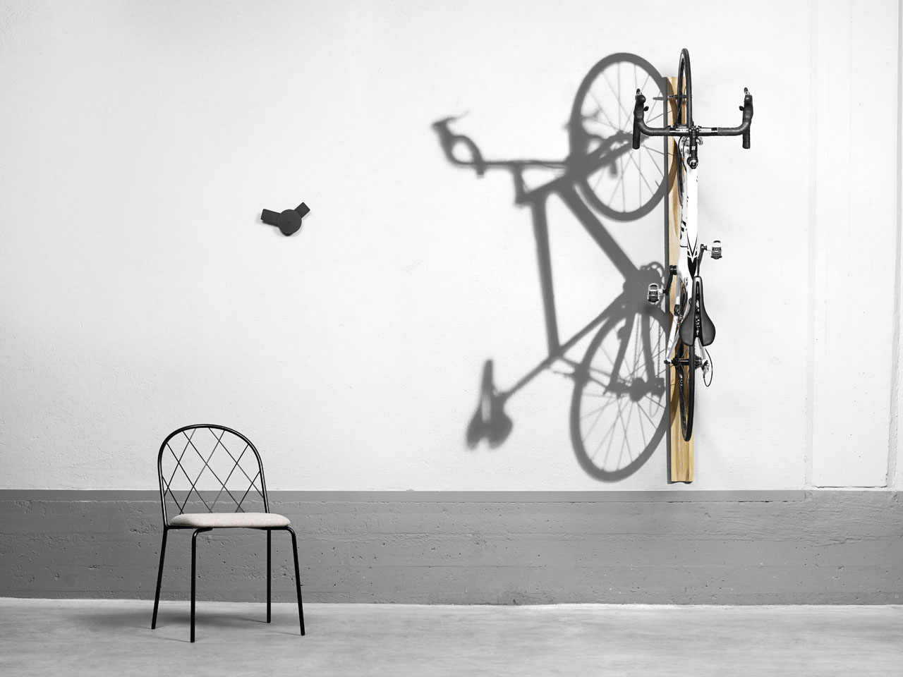 Mesh chair by Lars Hofsjö, O´clock  wall clock by Louise Hederström and Giro wall-mounted cycle rack by Mattias Stenberg for David Design.