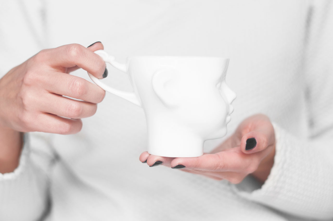 """DOLL HEAD MUG made of white porcelain by ENDE Art Studio founded by Natalia Gruszecka and Jakub Kwarciński presentedat the """"IRONICALLY ICONIC: UNEXPECTED DESIGN FOR EXPECTED USES"""" exhibition organized by Valorizzazioni Culturali 