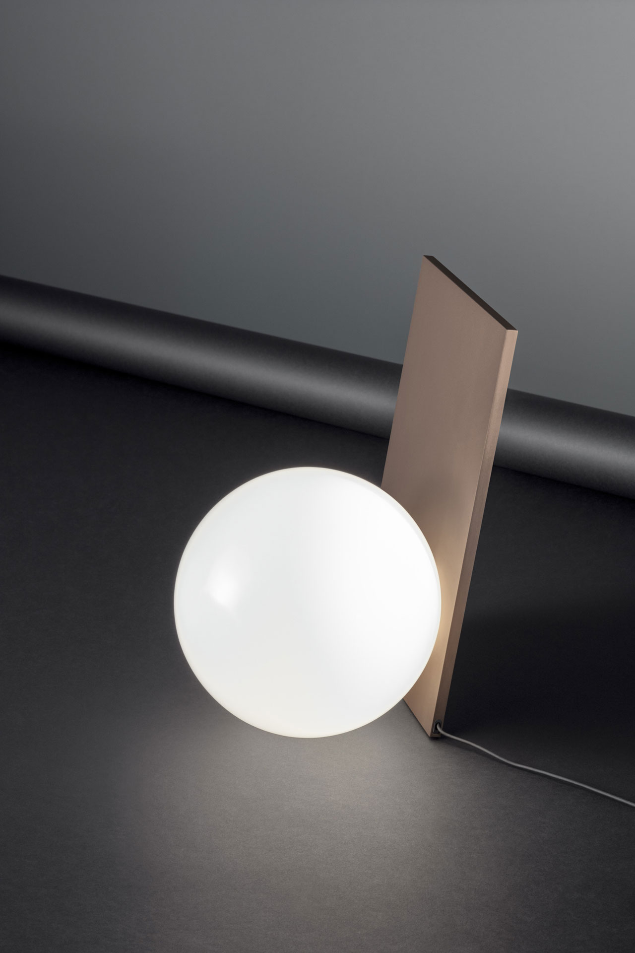 EXTRA table lamp byMichaelAnastassiades for FLOS.