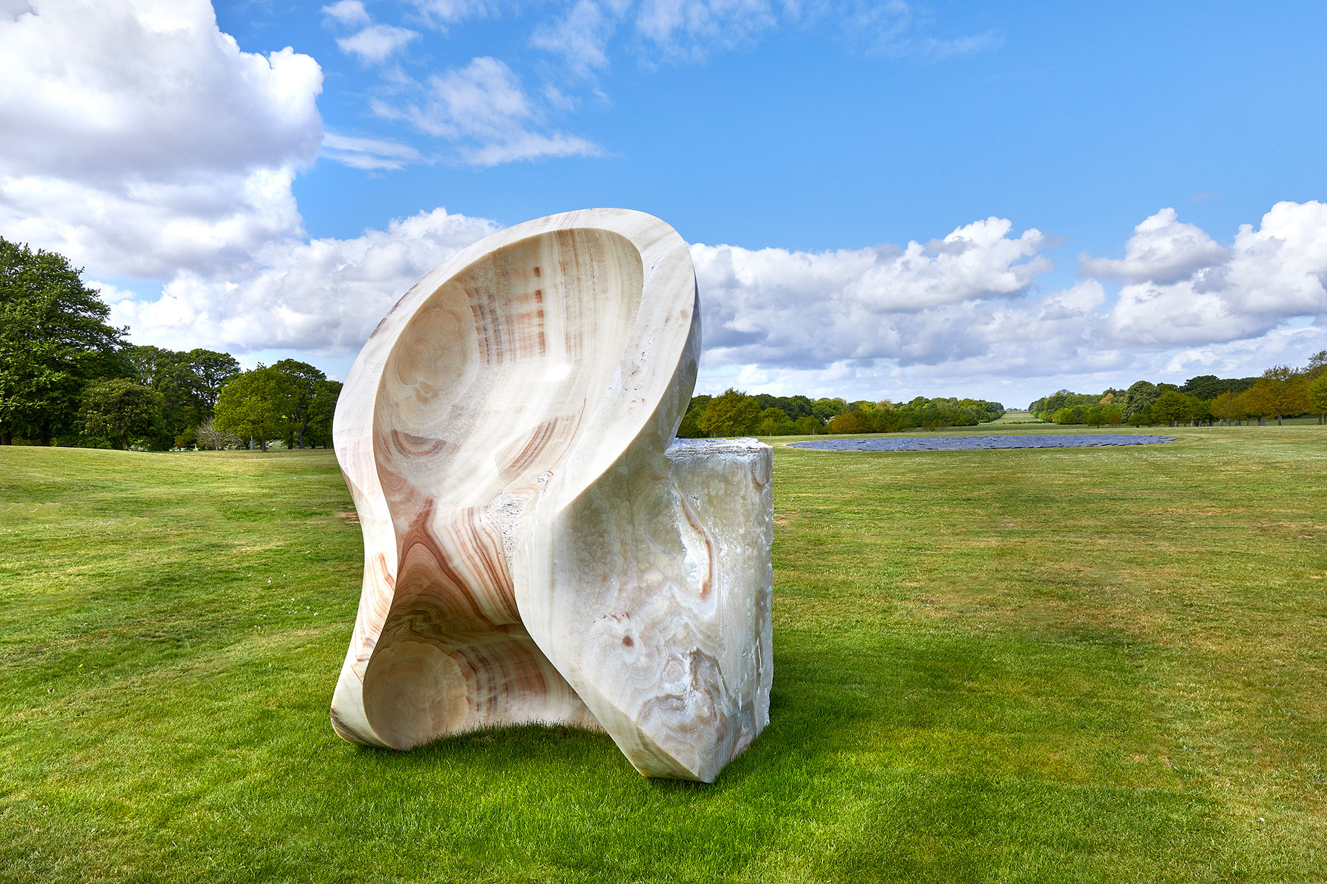 Exhibition view, Anish Kapoor at Houghton Hall. © Anish Kapoor. All rights reserved DACS, 2020. Photo by Pete Huggins. Featured: Eight Eight, 2004, onyx. Courtesy the artist and Lisson Gallery.