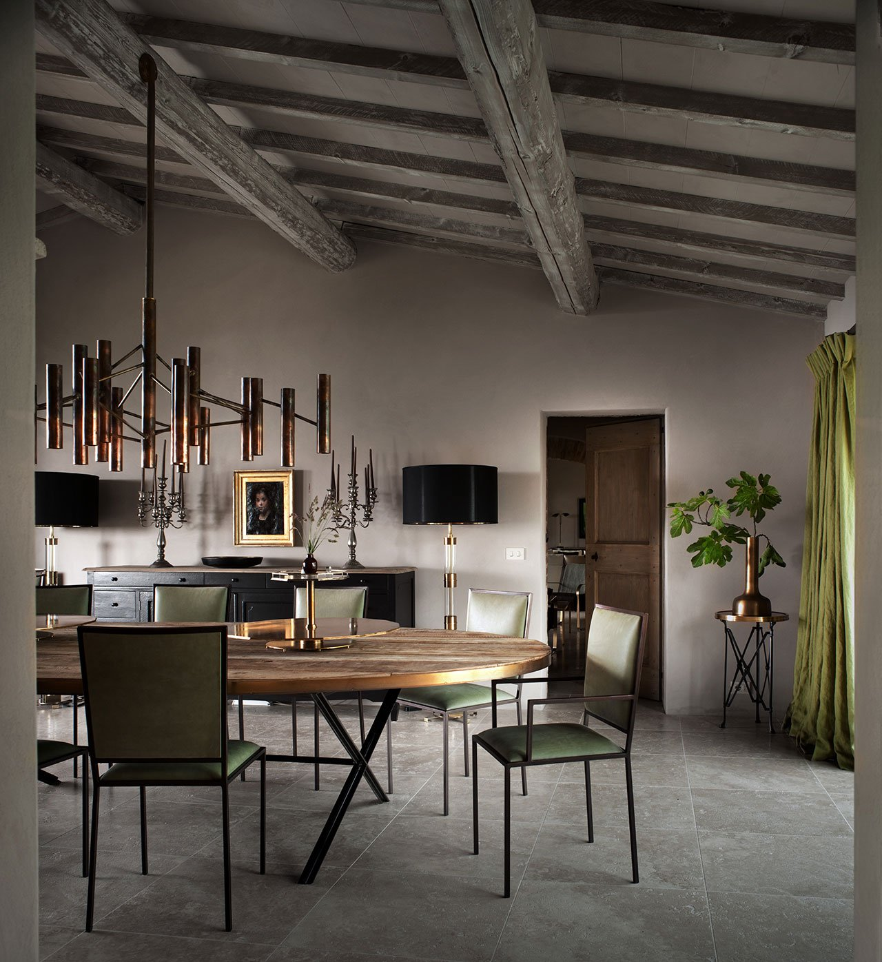 "B.B. for Reschio featuring ""The Oval Dining Table"", ""The Simple Chair"" and ""The Copper Tube Chandelier"". Photo © Reschio estate."