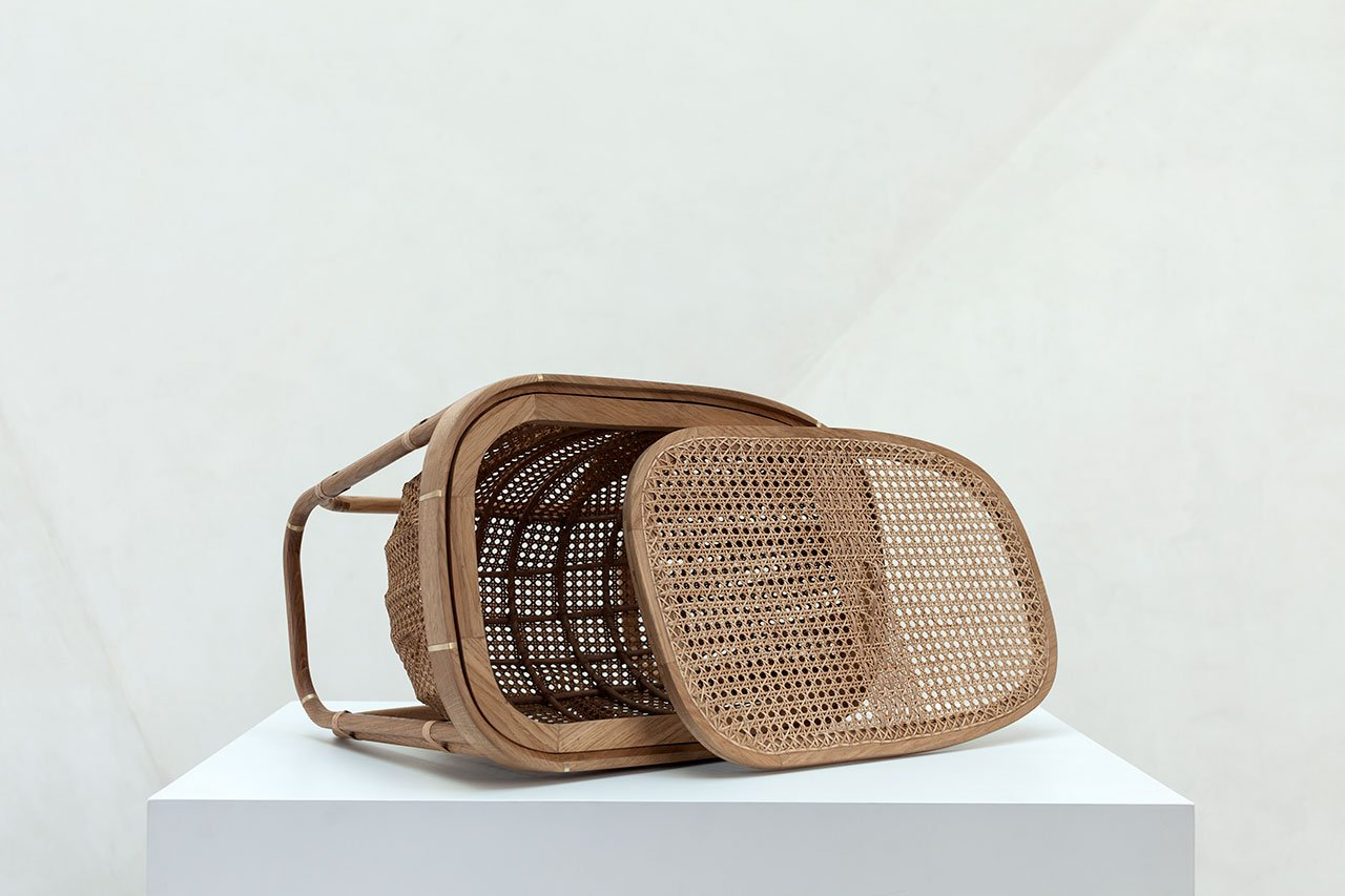 Fishawy Basket by by Khaled El Mays. Solid French oak, brass, rattan. 60 x 43 x 45 cm.