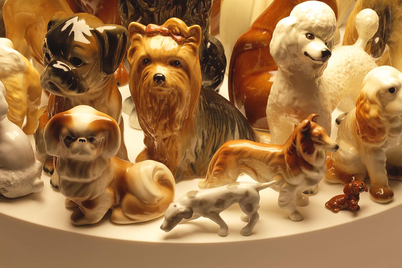 Stuart Haygarth,Raft(dogs), 2009. Corian, spun metal shade and dog figurines. Photo courtesy of the artist.