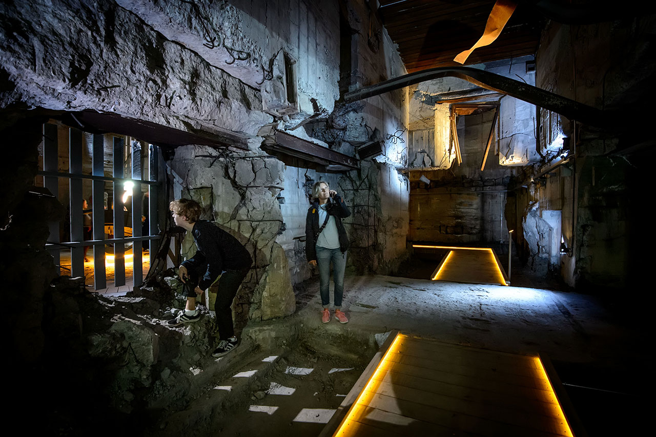 From the sunken galleries, visitors are able to walk into the historic bunker, which grounds the tale of an impressive war machine. Photo by Mike Bink Photography.