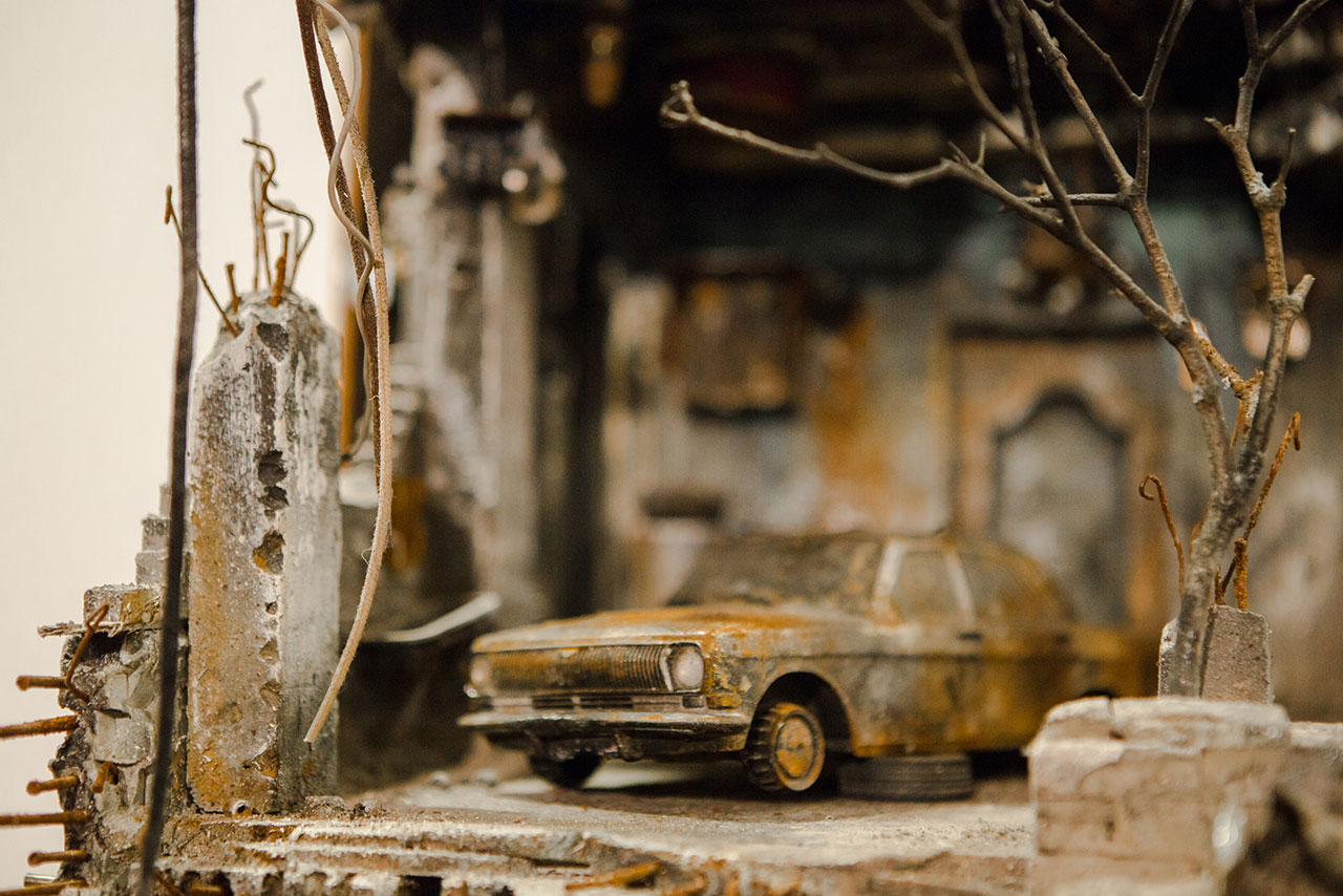 UM SHAHAM: War and a Burnt Car. Photo by Anisha Sisodia.