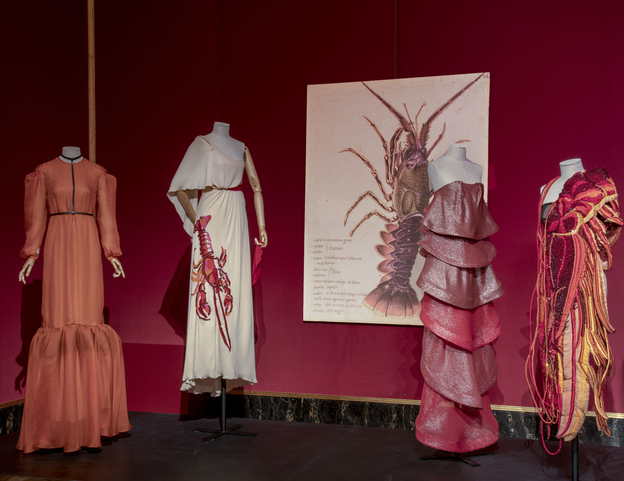 "Exhibition view (from left to right): Marios Schwab, Dress ""Isabel"". Fall/Winter 2015-16. Maison Schiaparelli, Dress ""La rose rouge"", Spring/Summer 2017. Yiqin Yin, Dress ""Voltige"", Moth Collection, Spring/Summer 2014 Haute Couture. Maison Margiela By Matthieu Blazy, Dress, Artisanal Collection, Fall/Winter 2014-15. Photo © Antonio Quattrone."