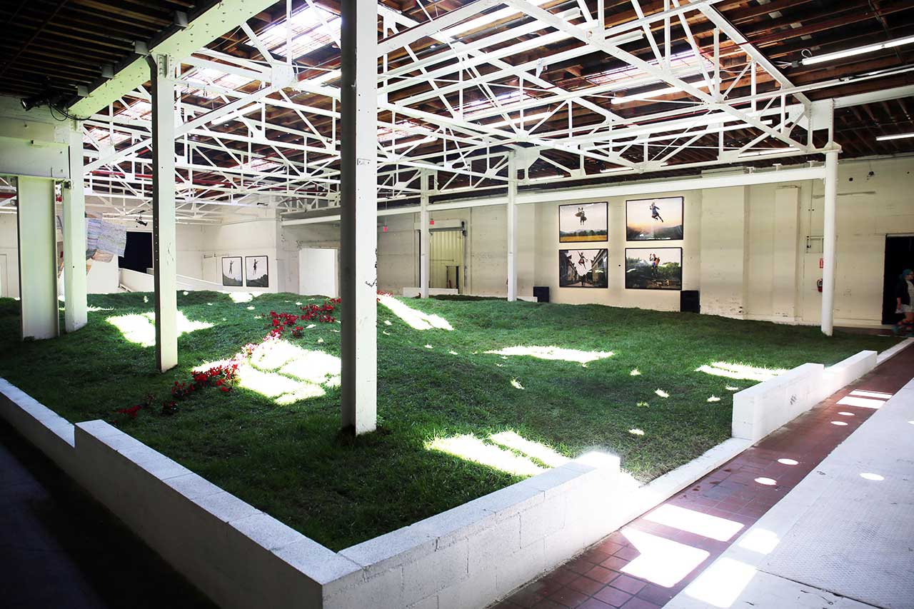 Simon Birch, Garlands, Lily Kwong and KplusK associates, 2016-17. Earth, grass, live flowers, steel, wood, swings. Installation view. Photo by Gloria Yu.