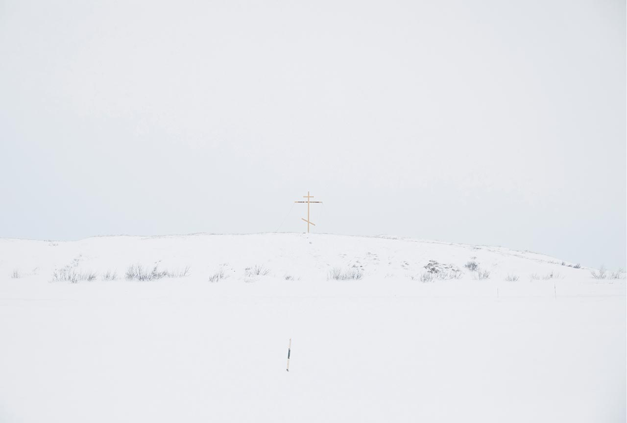"An improvised cross, which marks the border between the village and the tundra. Yamalo-Nenets Autonomous Okrug, Russia. For tundra people, this cross marks the border between their world and the world of the ""others"" (non-tundra people) as they refer to them. Crossing this border is accompanied by many fears and superstitions, both by tundra people and the ""others."" Photo © Oded Wagenstein."