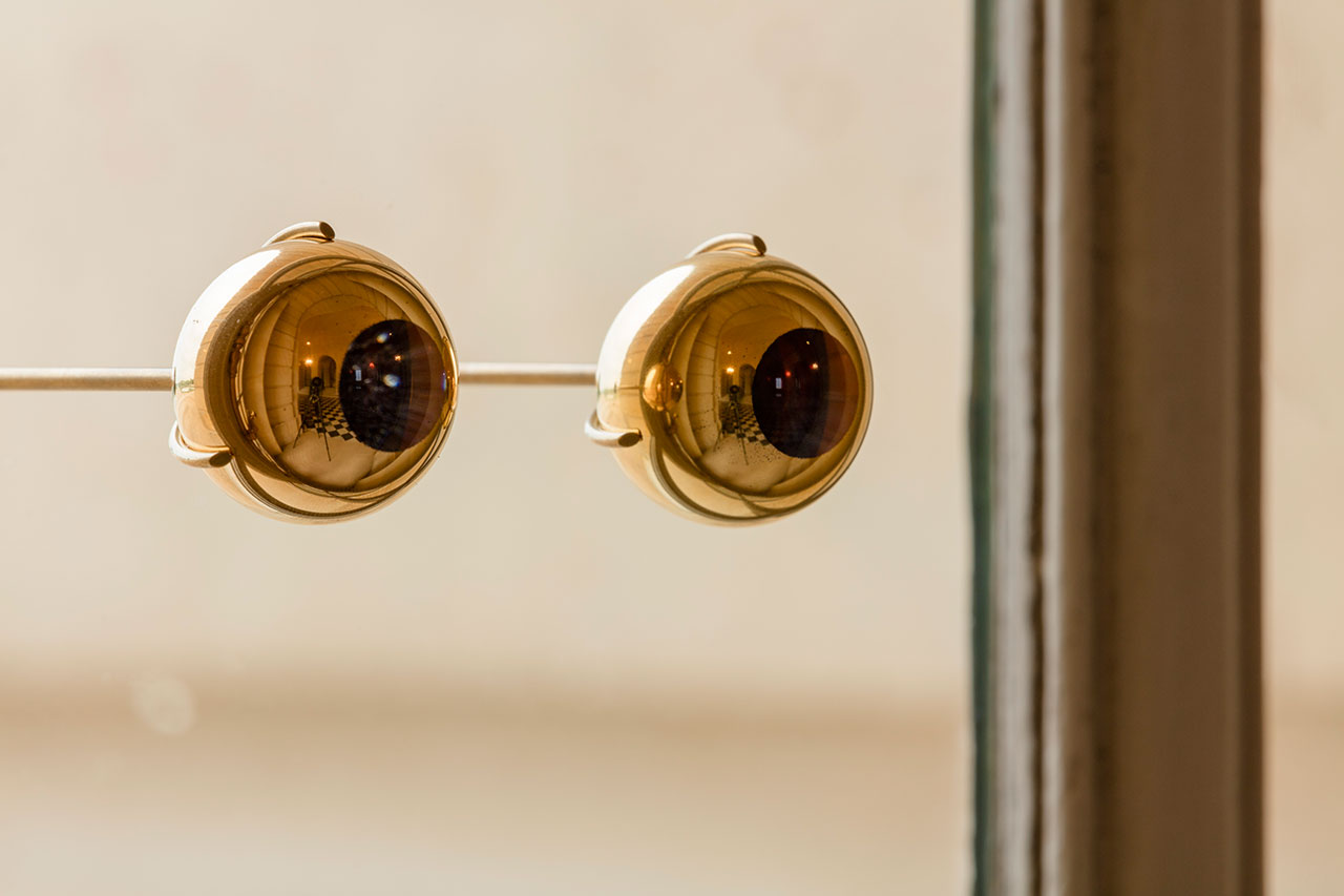 Olafur Eliasson,The gaze of Versailles, 2016. Glass sphere, gold, brass, in two parts. 4 x 11 x 12 cm, each sphere: 3.5 cm.Palace of Versailles, 2016. Photo by Anders Sune Berg. Courtesy the artist; neugerriemschneider, Berlin; Tanya Bonakdar Gallery, New York © Olafur Eliasson.